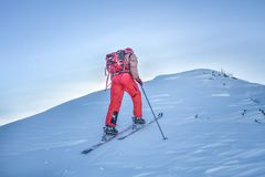 A skier walks in the mountains Royalty Free Stock Photo