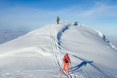 A skier walks in the mountains Stock Photography