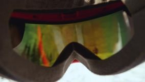 Skier wearing glasses on the background of sky with sun and mountains in slow motion. 1920x1080 stock video footage