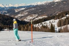 Skier with white Helmet Ready for Skiing in Ski Slope, Italian Dolomites Mountains in background.  Royalty Free Stock Photography