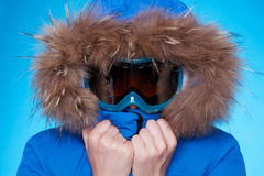 Skier in winter coat and mask feeling cold Royalty Free Stock Photos