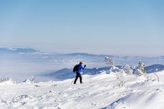 Skier in the winter mountain. RILA,BULGARIA ,JANUARY 15 : Teenager learning how to ski on a mountains background stock photography