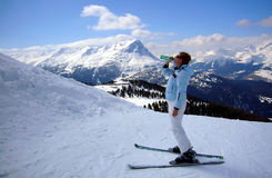 Skier woman drinking mineral water Royalty Free Stock Images
