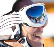 Skier woman with helmet. Portrait of a smiling skier woman with helmet Stock Photos