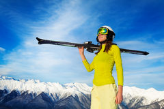 Skier woman in light clothes over sky Royalty Free Stock Photos