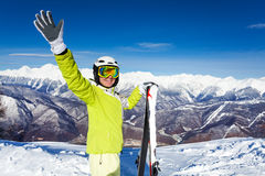 Skier woman wave hand and hold ski Stock Photo