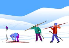 Skiers. Healthy lifestyle. Three young people go to snow hills and are going skiing. They are energetic and cheerful. Their colorful ski suits look beautiful Royalty Free Stock Photography