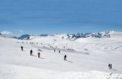 Skiers on Alpine ski slope Royalty Free Stock Images