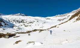 Skiers ascending a mountain slope. Royalty Free Stock Photography