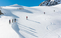Skiers ascending a mountain slope. Royalty Free Stock Photos