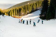 Skiers in Bansko ski resort, Bulgaria Royalty Free Stock Image