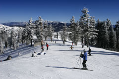 Skiers in Busy Ski Resort Royalty Free Stock Photos