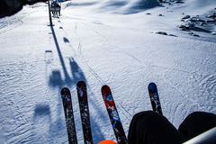 Skiers on the cable car. Arabba, Italy -  February 04, 2015: You can see sun rays on the snow field under the skiers running on cable car Royalty Free Stock Photo