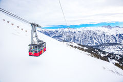 Skiers in cable car enjoying stunning view to Bavarian Alps, Fellhorn, Oberstdorf, Germany. Stock Photo