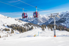 Skiers in cable car enjoying stunning view to Bavarian Alps, Fellhorn, Oberstdorf, Germany Royalty Free Stock Photography