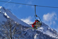 Skiers on the cable car royalty free stock image
