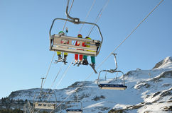 Skiers in the chair lift above the snow hill Stock Image