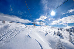 Skiers on the chair lift in Tyrolian Alps, Kitzbuehel, Austria Stock Photos