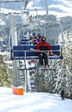 Skiers in chairlift royalty free stock image