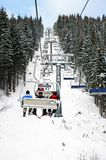 Skiers in chairlift Stock Photos