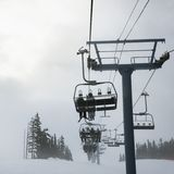 Skiers on chairlift. Stock Photography
