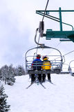 Skiers on chairlift stock photography