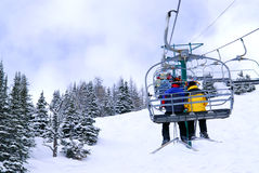 Skiers on chairlift royalty free stock image