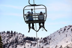 Skiers on chairlift Stock Image