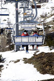 Skiers on chairlift. At ski resort Stock Photo