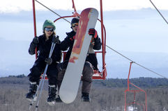Skiers on chairlift Royalty Free Stock Photos