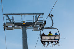 Skiers on chairlift in mountain Stock Image
