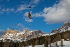 Skiers on chairlift in mountain Stock Photography