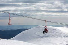Skiers on chairlift in moutain Royalty Free Stock Image