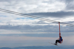 Skiers on chairlift in moutain Royalty Free Stock Photography