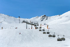 Skiers and chairlift in Solden, Austria Royalty Free Stock Photos