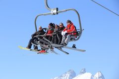 Skiers on a chairlift Royalty Free Stock Photo