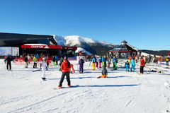 The skiers and Chopok cableway station in Jasna Low Tatras Stock Photos