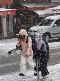 Skiers come back to town in a snowstorm Royalty Free Stock Photos