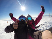 Skiers couple happy together in mountain Stock Image