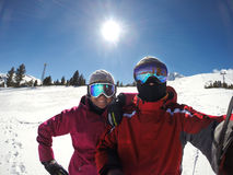 Skiers couple at winter holiday Royalty Free Stock Photography