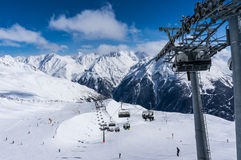 Skiers and double chairlift in Alpine ski resort in Solden Stock Image