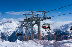 Skiers and double chairlift in Alpine ski resort in Solden Royalty Free Stock Images