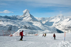 Skiers downhill skiing Royalty Free Stock Images