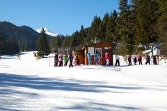 Skiers at the draglift in Bansko, Bulgaria Stock Photo