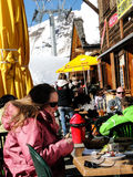 Skiers enjoy lunch outdoors Stock Images