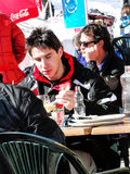 Skiers enjoy lunch outdoors Stock Photo