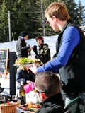 Skiers enjoy lunch outdoors Stock Photos
