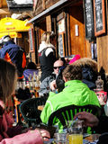 Skiers enjoy lunch outdoors Royalty Free Stock Photography
