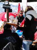 Skiers enjoy lunch outdoors Stock Photography
