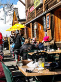 Skiers enjoy lunch outdoors Royalty Free Stock Images